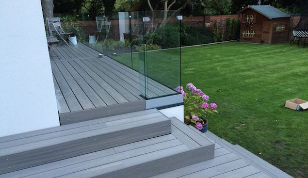 A composite decking balcony idea with steps down to the spacious garden