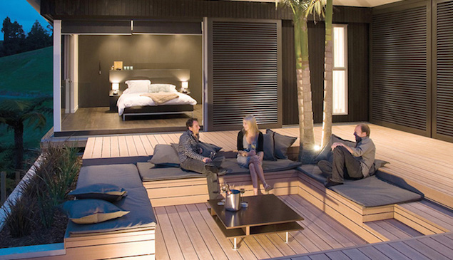 Stunning modern composite decking garden design with seating arrangements built in