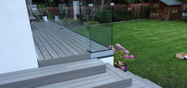 composite decking garden area with frameless glass balustrade