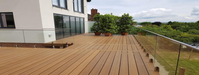 External glass balustrades on a decking space